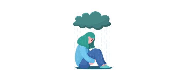 Depressed woman sitting under a rain cloud